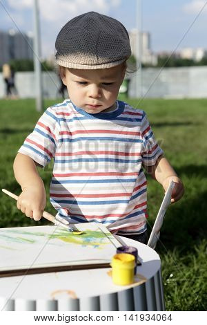 Boy Drawing Gouache