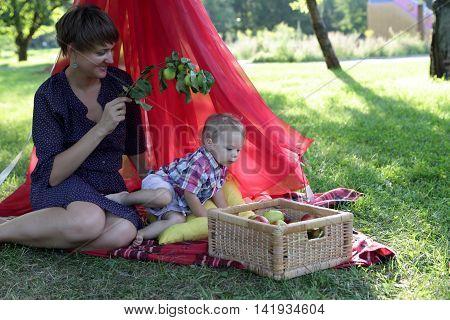 Family Resting On Rug