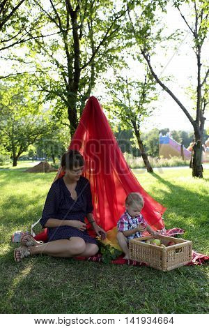 Mother With Son Resting On Rug
