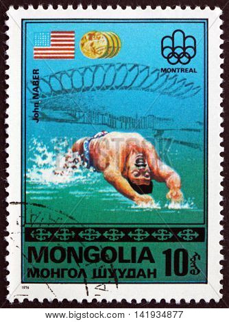 MONGOLIA - CIRCA 1976: a stamp printed in Mongolia shows John Naber US Flag Gold Medal Winner 21st Olympic Games Montreal circa 1976