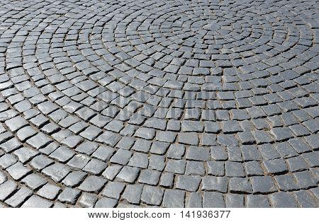 A beautiful circular antique black paved square