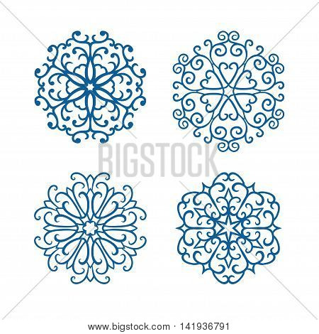 Vector set of four hand drawn curly blue snowflakes