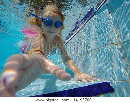 child playing in the swimming pool