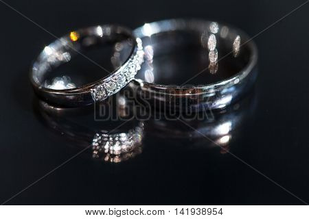 Wedding day details - two lovely golden wedding rings awaiting their moment, with some nice reflections