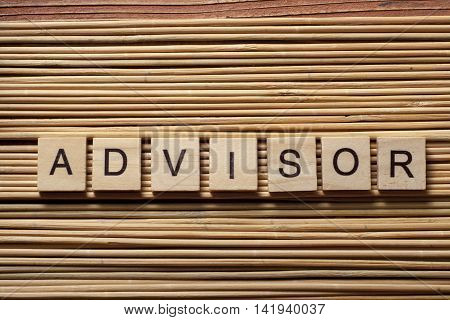 the word of ADVISOR on wooden cubes.