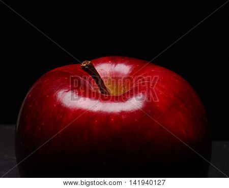 Red apple on black background.