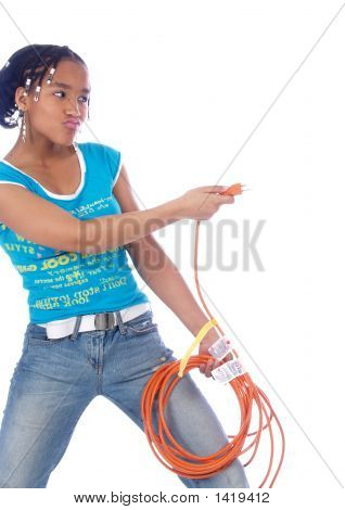 Young Girl Playing With Powercable