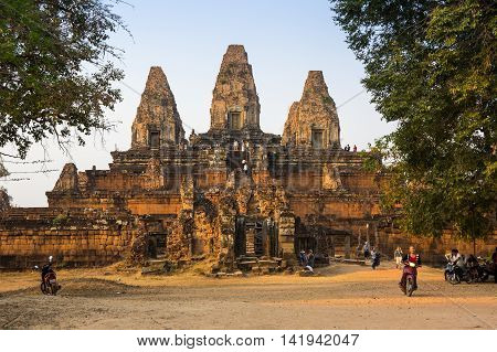 ANGKOR WAT CAMBODIA - JANUARY 28 2015: Phnom Bakheng at Angkor Cambodia is a Hindu and Buddhist temple in the form of a temple mountain dedicated to Shiva