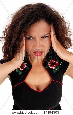 A closeup image of a pretty woman in a black dress holding booths hands on her head for migraine pain isolated for white background.