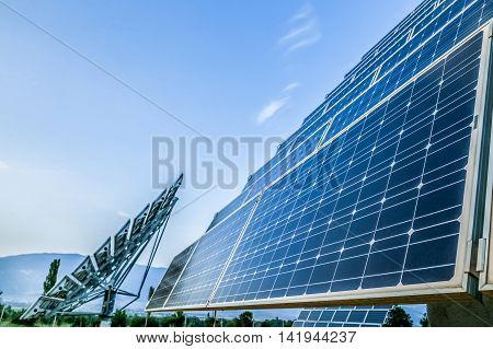 Blue solar photovoltaic panels and sky background