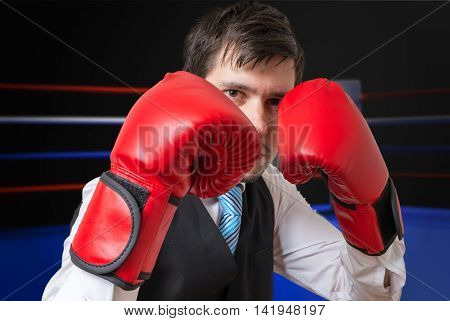 Businessman Is Boxing And Fighting In Ring.