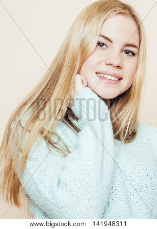 young pretty real blond teenage girl close up portrait, lifestyle people concept