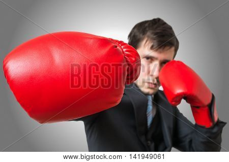 Punch Of Boxing Businessman In Suit. Fighting Concept.