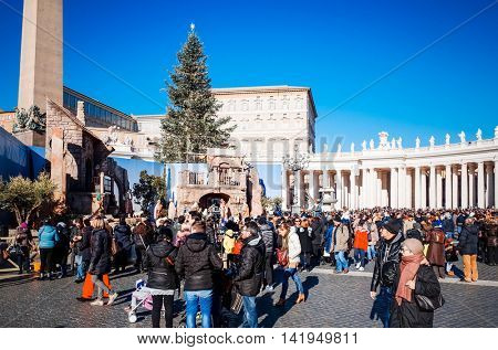 VATICAN CITY,VATICAN - January 6, 2015 : Tourists on foot Saint Peter's Square in Vatican on January 6, 2015.is the smallest internationally recognized independent state in the world, Vatican.