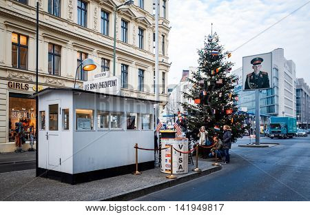 BERLIN, GERMANY- 14 December: Checkpoint Charlie. Former bordercross in Berlin on 14 December, 2014. Berlin Wall crossing point between East and West Berlin during the Cold War. BERLIN, GERMANY