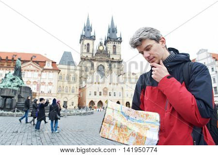 male tourist with touristic map
