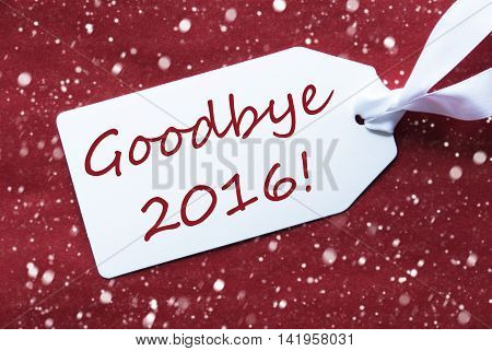 One White Label On A Red Textured Background. Tag With Ribbon And Snowflakes. English Text Goodbye 2016 For Happy New Year