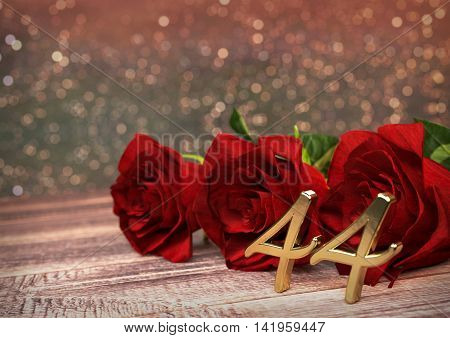 birthday concept with red roses on wooden desk. 3D render - forty-fourth birthday. 44th