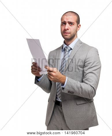 Worried businessman holding a document