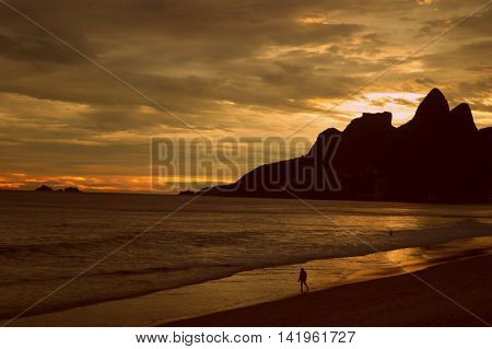 A typical sunset in Rio de Janeiro with the sea and the mountain