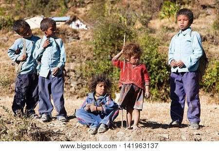 DOGADI VILLAGE WESTERN NEPAL - 8TH OF DECEMBER 2013 - group of nepalese children in western Nepal