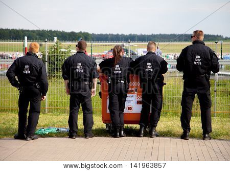 BERLIN / GERMANY - JUNE 06 2016: german police officers stands together on an air show in berlin at june 06 2016.