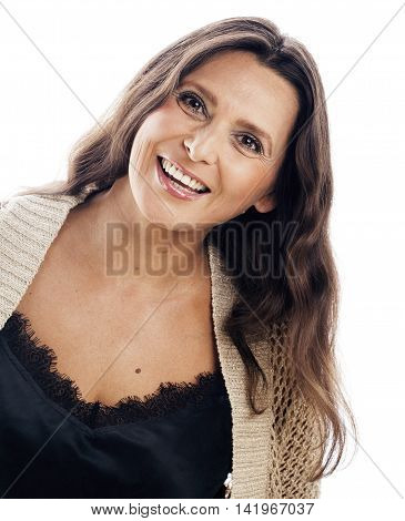 mature brunette real middle age woman well dressed posing smiling isolated on white background, happy aging concept