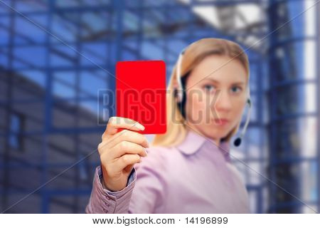 red card in hand bussiness woman