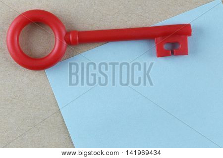Red Plastic key is placed on Blue Paper Note and can input text to it.