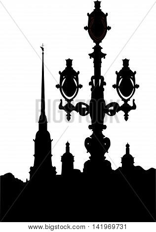 black-and-white silhouette of the Peter and Paul Fortress and streetlight in the city of St. Petersburg