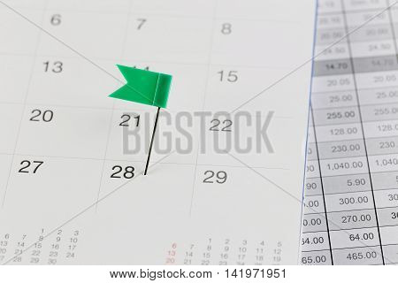 Green Pins to Wildcats on the calendar beside the number of twenty eight in business concept time and date.