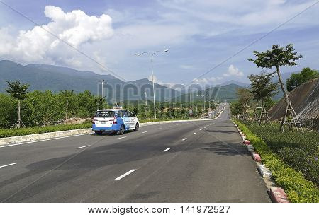 Da Nang, Vietnam - Jun 20, 2016: A taxi carrying tourist from city center to Ba Na Hills mountain resort. The resort is held and managed by one of the biggest Vietnamese corporation, Sun Group.