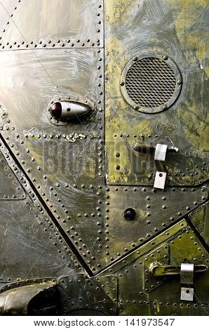 Old military armor texture with rivets. Metal background.