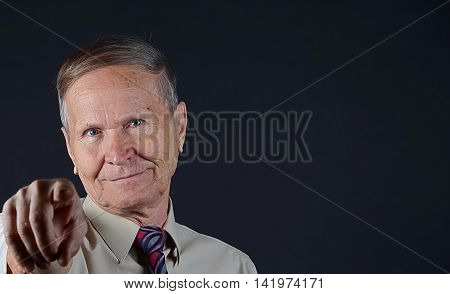 Business man close up portrait  pointing with his point finger, copy space, isolated on black background