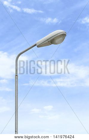 street lights illuminated in blue sky background