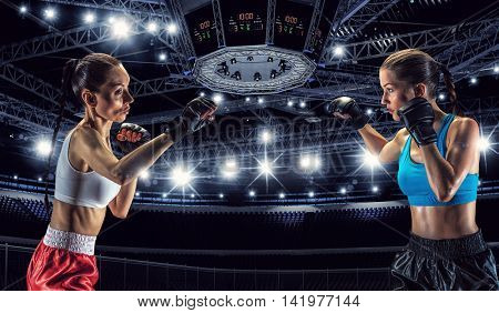 Girls boxing in ring . Mixed media