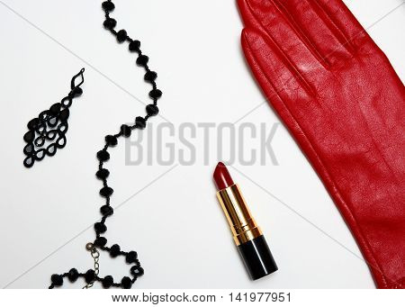Flat lay feminine red and black fashion accessories collage on white background.