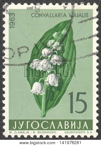 MOSCOW RUSSIA - CIRCA MAY 2016: a post stamp printed in YUGOSLAVIA shows a Convallaria majalis flower the series