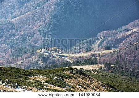 Lift station in Low Tatras mountains. Cable car to the Chopok peak. Natural scene. Valley with coniferous forest. Travelling theme.
