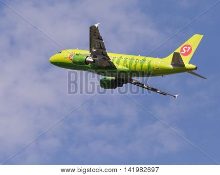 The Moscow region - July 31 2016: Bright green passenger aircraft Airbus A319-114 S7 Airlines takes off and takes place in Domodedovo airport July 31 2016 Moscow Region Russia