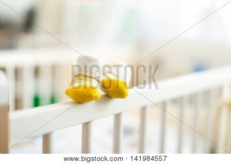 baby booties on a cot crib for infants
