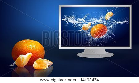 Fresh fruits in water on monitor