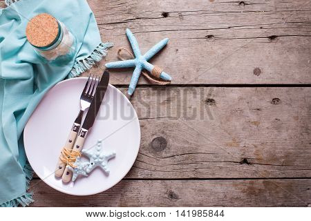Marine table setting on aged wooden background. Selective focus. Place for text. Flat lay.