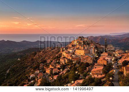 Late Evening Sunshine On Mountain Village Of Speloncato In Corsica