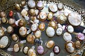 picture of cameos  - Colorful antique cameos on a mirror for sale at an Antique Shop - JPG