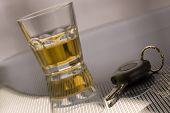 stock photo of underage  - car keys with glass of whiskey in background  - JPG