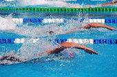 picture of swim meet  - swimming in waterpool with blue water - JPG