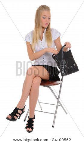 The Woman Looking In Handbag.