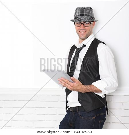 Smiling funny guy using electronic tablet