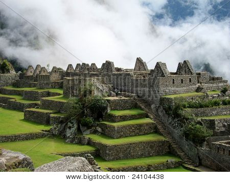 Ruins of Machu Picchu in morning fog, Peru